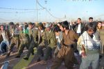 Young men in kurdish guerrilla outfits dance during Newroz   Photo property of Shiler Amini