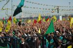 Millions raise their hands to do the victory sign when the kurdish national anthem is presented  Photo property of Shiler Amini